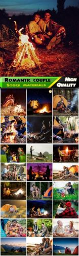 Romantic couple of man and woman hugging by the campfire Stock images
